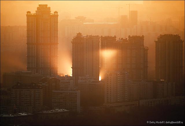 Sunlight reflection in sunset cityscape