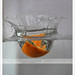 Water Splashed by 1/4 of Orange - Action Freezed by {ahradwani.com} Hawee Ta3kees-هاوي تعكيس