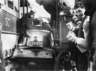 Motor vehicle squashed between two early electric trams, Brisbane