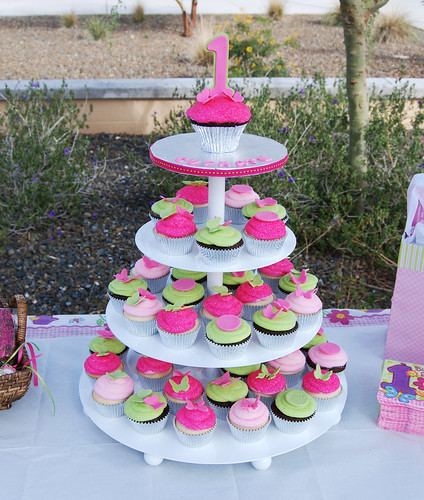 pink and green first birthday cupcake tower