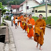 Early daily alms rounds through town