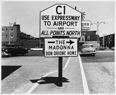 North Exit of Sumner Tunnel, with Directional Signs for Logan Airport and The Madonna Don Orione Home