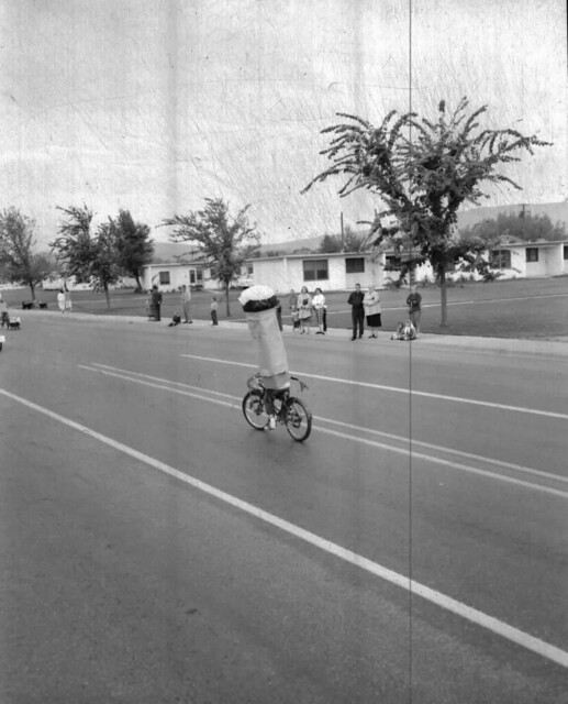 Fire Prevention Parade, 1955, Kid in Dangerous Cosume on Bike
