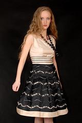 gown(0.0), skirt(0.0), fashion show(0.0), little black dress(0.0), miniskirt(0.0), model(1.0), clothing(1.0), abdomen(1.0), cocktail dress(1.0), fashion(1.0), photo shoot(1.0), blond(1.0), dress(1.0),