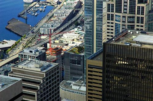 Green garden, top of Seattle skyscraper, crane, Puget Sound, Washington, USA by Wonderlane