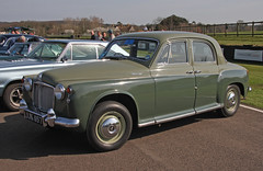 rolls-royce phantom vi(0.0), rolls-royce phantom v(0.0), austin fx4(0.0), mercedes-benz w120(0.0), rolls-royce silver cloud(0.0), compact car(0.0), automobile(1.0), vehicle(1.0), rover p4(1.0), mid-size car(1.0), antique car(1.0), sedan(1.0), classic car(1.0), vintage car(1.0), land vehicle(1.0), luxury vehicle(1.0),