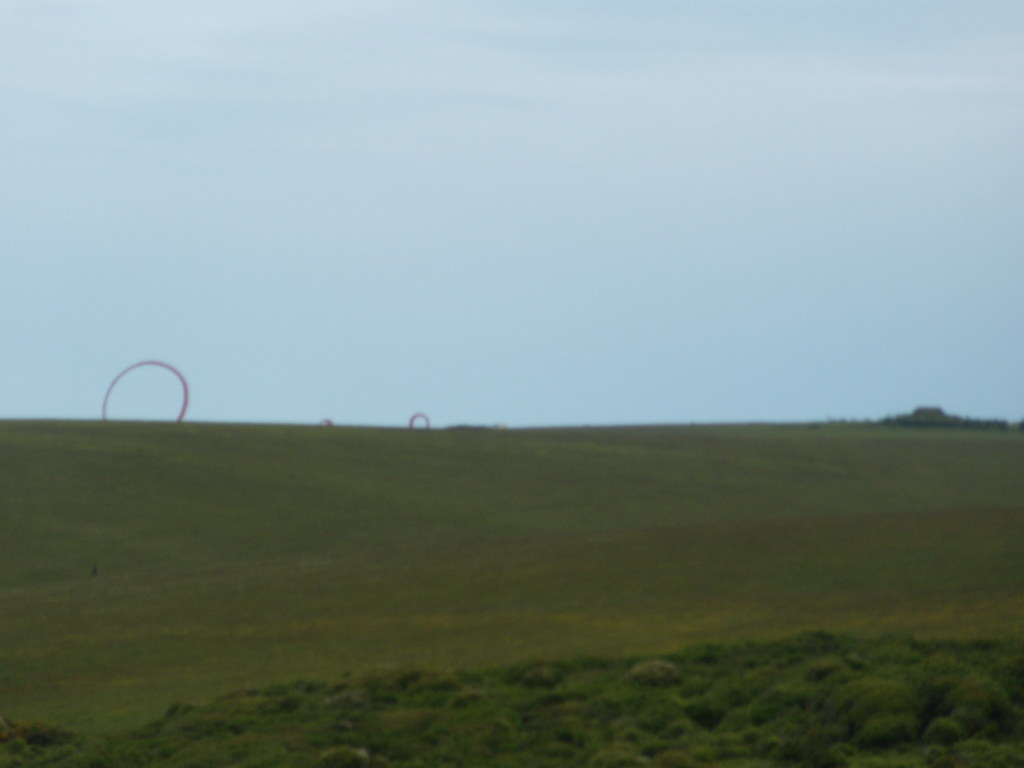 Red Circles Not sure what these were, wobbling over the horizon. Infeasibly large kites, art? seaford - Eastbourne