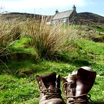Unoccupied hiking boots on a lovely hillside after a hard day's walk, by David Maters