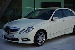 mercedes-benz w221(0.0), automobile(1.0), automotive exterior(1.0), executive car(1.0), mercedes-benz w212(1.0), wheel(1.0), vehicle(1.0), automotive design(1.0), mercedes-benz(1.0), bumper(1.0), mercedes-benz e-class(1.0), sedan(1.0), land vehicle(1.0), luxury vehicle(1.0),
