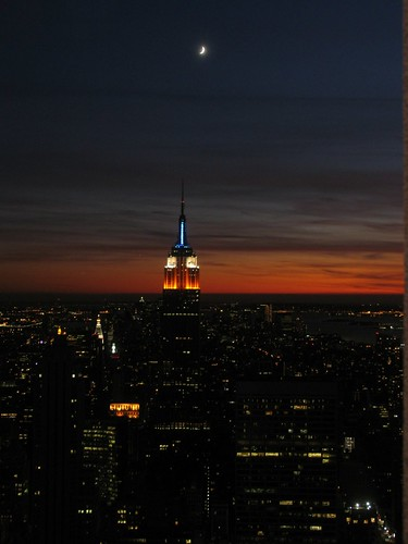 city nyc newyorkcity light sunset sky orange moon newyork night clouds view cloudy rockefellercenter explore empirestatebuilding 1001nights topoftherock supershot mywinners overtheexcellence