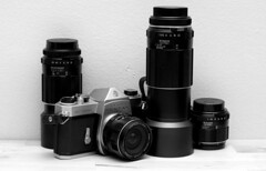 binoculars(0.0), cameras & optics(1.0), digital camera(1.0), camera(1.0), optical instrument(1.0), lens(1.0), camera lens(1.0),