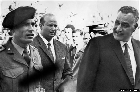 Col. Qaddafi after he seized power with the overthrow of the Monarchy in Libya in 1969. He is shown here with Egyptian leader Gamel Abdel Nassar. by Pan-African News Wire File Photos
