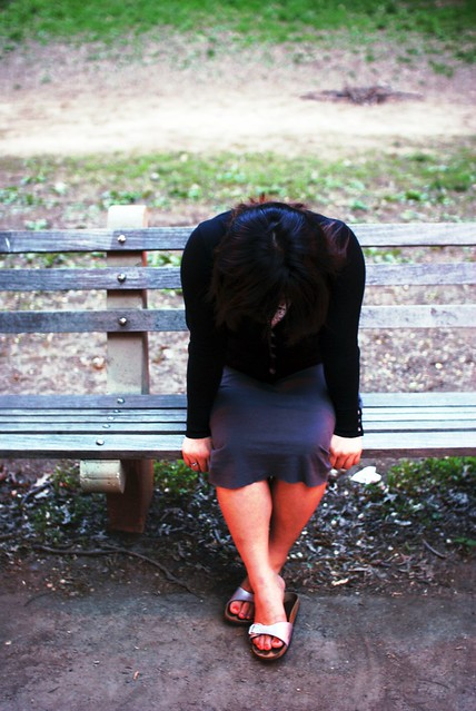 Crying girl on bench from Flickr via Wylio