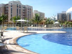 plaza(0.0), marina(0.0), resort town(1.0), swimming pool(1.0), property(1.0), estate(1.0), reflecting pool(1.0), resort(1.0), real estate(1.0), condominium(1.0), apartment(1.0),