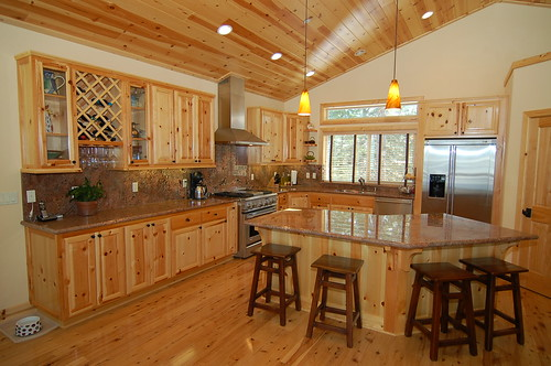 House ideas on pinterest knotty pine kitchen hickory for Pine kitchen cabinets