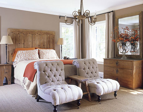 Calm neutrals + orange accents in Belgian-style bedroom