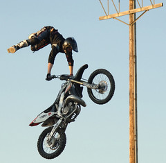 Motorcycle jumper flys in the air