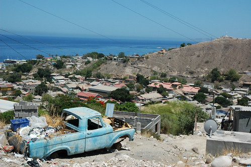 Where a black dog lives inside a blue pickup truck loaded with junk, no wheels, The city of wood, French influenced, mining town, Sea of Cortez, San Rosalia, Baja California Sur, Mexico by Wonderlane