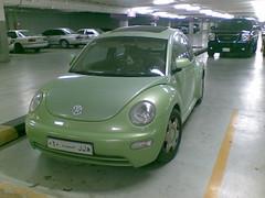 minivan(0.0), mid-size car(0.0), automobile(1.0), volkswagen beetle(1.0), automotive exterior(1.0), wheel(1.0), volkswagen(1.0), vehicle(1.0), automotive design(1.0), volkswagen new beetle(1.0), subcompact car(1.0), city car(1.0), compact car(1.0), bumper(1.0), sedan(1.0), land vehicle(1.0),