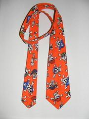 scarf(0.0), art(1.0), orange(1.0), pattern(1.0), textile(1.0), clothing(1.0), design(1.0), necktie(1.0),