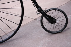 automotive tire(0.0), mountain bike(0.0), road bicycle(0.0), bicycle motocross(0.0), bmx bike(0.0), sports equipment(0.0), cycle sport(0.0), bicycle frame(0.0), bicycle(0.0), tire(1.0), wheel(1.0), vehicle(1.0), rim(1.0), iron(1.0), land vehicle(1.0), bicycle wheel(1.0), spoke(1.0), tarmac(1.0),
