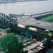 NS 2329 met goederentrein passeert de bruggen over de Oude Maas te Rotterdam, 30 april 1985