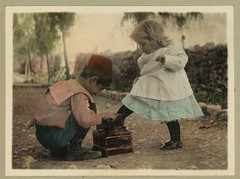 Vintage Picture of Two Children, A Cute Boy giving a Shoe Shine to a Beautiful Little Blonde Girl