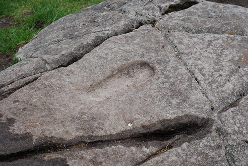 The footprint carving in the ogham-inscribed stone at the top of Dunadd; thought to have been used in inauguration rituals of Dal Riatan kings