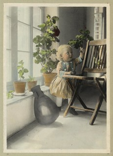 Vintage Portrait Photo Picture of a Little Blonde Girl in a Room of Plants and Sunshine
