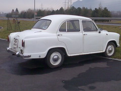 mid-size car(0.0), saab 96(0.0), automobile(1.0), vehicle(1.0), hindustan ambassador(1.0), compact car(1.0), antique car(1.0), sedan(1.0), classic car(1.0), land vehicle(1.0), luxury vehicle(1.0),
