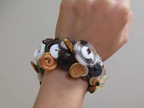 Arm with upcycled button bracelet