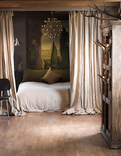 Dutch design: Luxe drapes and lush neutrals in gorgeous canal house bedroom