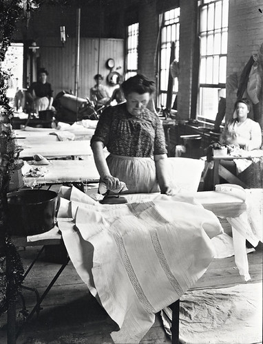 Woman ironing a starched petticoat, M. T. S., QC, about 1901