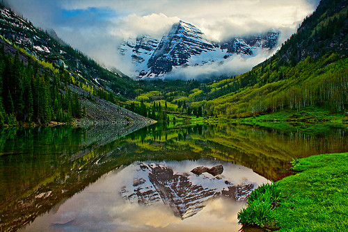 trees sunset sky lake snow storm mountains reflection green grass clouds forest evening colorado famous aspens wilderness peaks aspen rugged clearing 14ers maroonbells worldrenowned 14000feet deadlybells paulgana