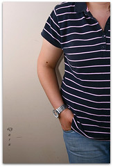 maroon(0.0), human body(0.0), design(0.0), brand(0.0), arm(1.0), neck(1.0), clothing(1.0), collar(1.0), sleeve(1.0), polo shirt(1.0), pocket(1.0), t-shirt(1.0),