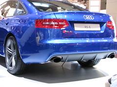 grille(0.0), sports car(0.0), automobile(1.0), automotive exterior(1.0), audi(1.0), executive car(1.0), family car(1.0), wheel(1.0), vehicle(1.0), automotive design(1.0), audi rs 6(1.0), rim(1.0), bumper(1.0), sedan(1.0), land vehicle(1.0), luxury vehicle(1.0), vehicle registration plate(1.0),