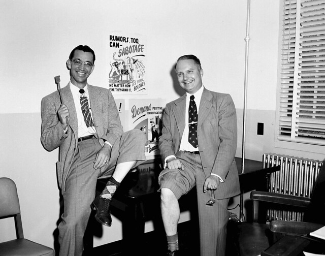 1951 HAYNES AND SCHUMAN WITH SECURITY POSTERS