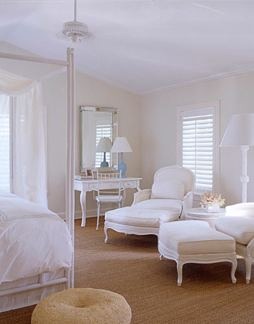 White bedroom: French bergeres + grass rug + 'Seashell' by Benjamin Moore