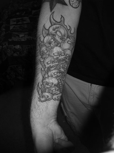 Flaming pile of skulls Drawn and tattooed by Big Mike