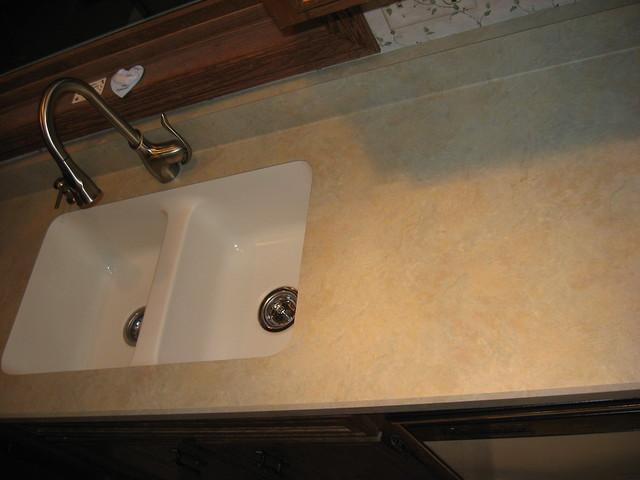 AFTER The sink is high density acrylic Karran under moun…