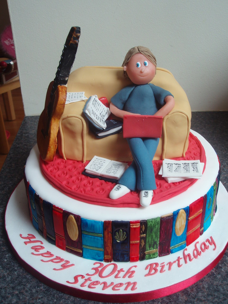 30th Birthday Cake With Books Laptop And Guitar Sitting On Couch