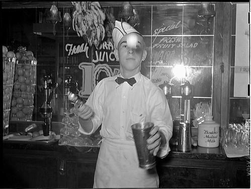 Soda jerker flipping ice cream into malted milk shakes. Corpus Christi, Texas (LOC)