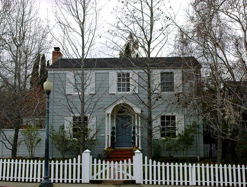 Gray winter house with a white picket fence, San Mateo, California, USA