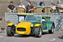 racing(0.0), performance car(0.0), race car(1.0), automobile(1.0), lotus seven(1.0), vehicle(1.0), automotive design(1.0), caterham 7(1.0), antique car(1.0), vintage car(1.0), land vehicle(1.0), sports car(1.0),