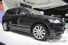 executive car(0.0), saab 9-4x(0.0), audi q5(0.0), volvo xc60(0.0), automobile(1.0), automotive exterior(1.0), sport utility vehicle(1.0), wheel(1.0), volkswagen(1.0), vehicle(1.0), automotive design(1.0), rim(1.0), volkswagen touareg(1.0), bumper(1.0), land vehicle(1.0), luxury vehicle(1.0),
