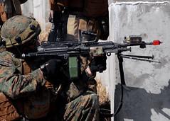 shooting sport(0.0), games(0.0), paintball(0.0), army(1.0), soldier(1.0), weapon(1.0), shooting(1.0), machine gun(1.0), firearm(1.0), gun(1.0), military(1.0),