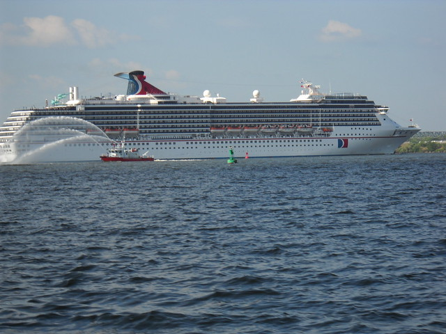 CARNIVAL CRUISE SHIP IN BALTIMORE HARBOR WITH FIRE BOAT