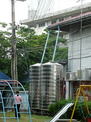 greenhouse(0.0), outdoor structure(0.0), mast(0.0), scaffolding(0.0), silo(1.0),
