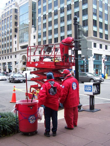 Painting a traffic signal pole, Downtown DC Business Improvement District