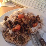 Pork chop with rice, mushroom and tomato